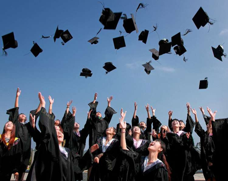 Graduates-Throwing-Their-Hats